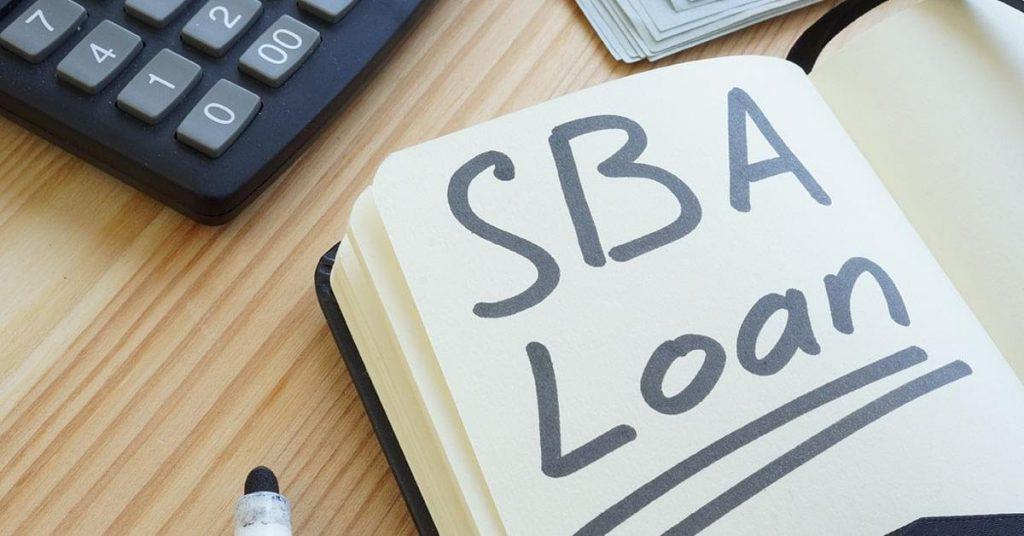 SBA Loan by CDC written on a book